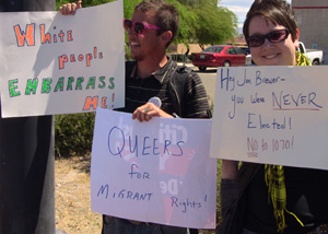 Queer protesters display signs