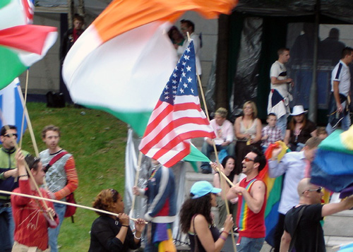 Queer protesters wave their flags in Dublin, Ireland